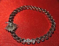 14 K White Gold Blue Topaz Tennis Bracelet 7.5 inches with flower clasp