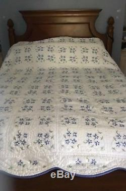 Handmade quilt 80 x 100. Cross-stitched by hand. White with blue flowers